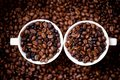 Detail of white cups of coffee filled with coffee beans aromatic and fresh african Royalty Free Stock Photography