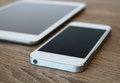 Detail of white mobile phone and white tablet Royalty Free Stock Photo