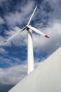 Detail of wind mill power turbine under cloudy sky Royalty Free Stock Images