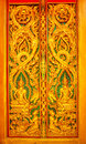 Detail of wooden door details the the temple thailand Royalty Free Stock Photography