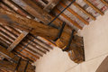 Detail of a wooden roof beam an old italian building Stock Photo