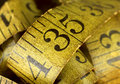 Detail of worn and cracked old measuring tape Royalty Free Stock Photography