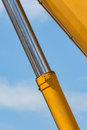 Detail of yellow hydraulic pipe Royalty Free Stock Photo