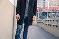 Detail of a young man posing in an urban context Royalty Free Stock Photo