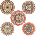 Detailed abstract colorful floral mandala circles for design element - Stock Vector Royalty Free Stock Photo