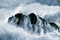 Detailed big crashing wave photo of a stormy over a boulder Royalty Free Stock Photo