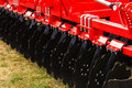 Detailed closeup of disc harrow agricultural machinery