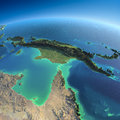 Detailed earth australia and papua new guinea highly planet in the morning exaggerated precise relief lit morning sun Stock Photo
