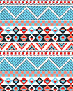 Detailed ethnic design triangle in black blue and red on white Royalty Free Stock Photo