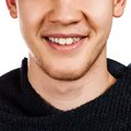 Detailed image of young man smiling with perfect white teeth Stock Photos