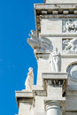 Detailed richly decorated architectonic part from the arch of the victoria square in genoa italy Stock Image