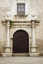 Details and entry way of an ancient church in historical merida mexico stained glass window central Stock Image