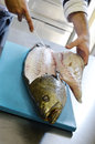 Details filleting fish on a cutting board Royalty Free Stock Photo