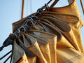 Details of gathered sail of a large sailing ship Royalty Free Stock Photo