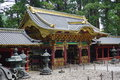 Details of a golden Toshogu complex in the town of Nikko, Japan, with both Shinto and Buddhist elements and wooden carvings