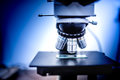 details of industrial scientific microscope used in medical, chemical and biochemistry fields Royalty Free Stock Photo