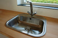 Details of modern kitchen sink with tap faucet Royalty Free Stock Photo