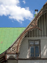 Details of an old abandoned house wooden against a blue sky with white clouds Stock Images