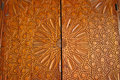 Details of an ornate carved cedar door at the Madrasa Bou Inania Royalty Free Stock Photo