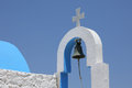Details of a small greek church with bell and cross Royalty Free Stock Images