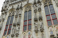 Details of town hall stadhuis bruges looking up at statues and windows or burg square west flanders belgium europe Royalty Free Stock Images