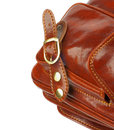 Details of traveling bag ginger leather with pocket fastener and back stitch isolated on white background Stock Photos