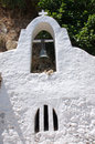 Details of white of a byzantine church at agios nikolaos crete greece pictorial bell tower the remains the are dated form Stock Photography