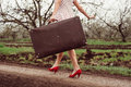 Details of woman holding retro suitcase Royalty Free Stock Photo