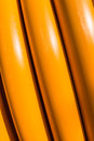 Details of yellow hoses in sunlight closeup thick on a reel Royalty Free Stock Image