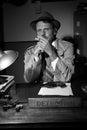 Detective smoking at desk Royalty Free Stock Photo
