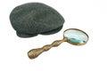 Detective warm cap y lupa del vintage Fotos de archivo libres de regalías