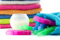 Detergent ball and clothes pegs a pile of towels isolated Royalty Free Stock Photography