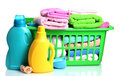 Detergents and towels in green plastic basket Royalty Free Stock Photos