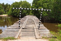 Deteriorated wooden bridge cross the river Royalty Free Stock Photos