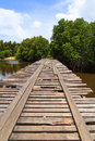 Deteriorated wooden bridge cross the river Stock Photos