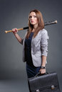 Determination studio portrait of a courageous and decided woman with baseball bat Stock Image