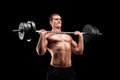Determined athlete lifting a heavy weight on black background Royalty Free Stock Photo