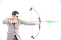 Determined businessman aiming at target, bow and