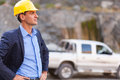 Determined mine manager handsome visit mining site Royalty Free Stock Image