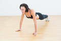 Determined sporty woman doing push ups in fitness studio beautiful young Stock Photos