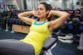 Determined woman doing sit ups at the gym Royalty Free Stock Photos