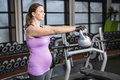 Determined woman lifting kettlebell Royalty Free Stock Photo