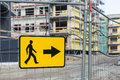 Detour sign for pedestrian sidewalk road near construction site Royalty Free Stock Images
