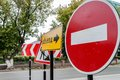 Detour signs on the road forbidding movement directly and reporting about direction of a Royalty Free Stock Images