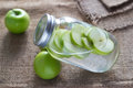 Detox diet fresh green apples soak in water of the jar on sack Royalty Free Stock Photo