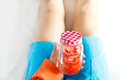 Detox diet fresh red tomato soak in water of the jar in woman hand soft focus Royalty Free Stock Photography