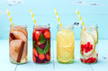 Detox fruit infused flavored water. Refreshing summer homemade cocktail. Clean eating. Royalty Free Stock Photo