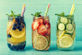 Detox fruit infused flavored water. Refreshing summer homemade cocktail. Clean eating. Copy space.