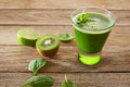 Detox green juice cleansing recipe with also kiwi lemon cucumber spinach Stock Image