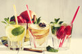 Detox water cocktail. Fresh vegetables and fruits in a glass bowl. Strawberry, apple, cucumber, lemon and mint. Royalty Free Stock Photo